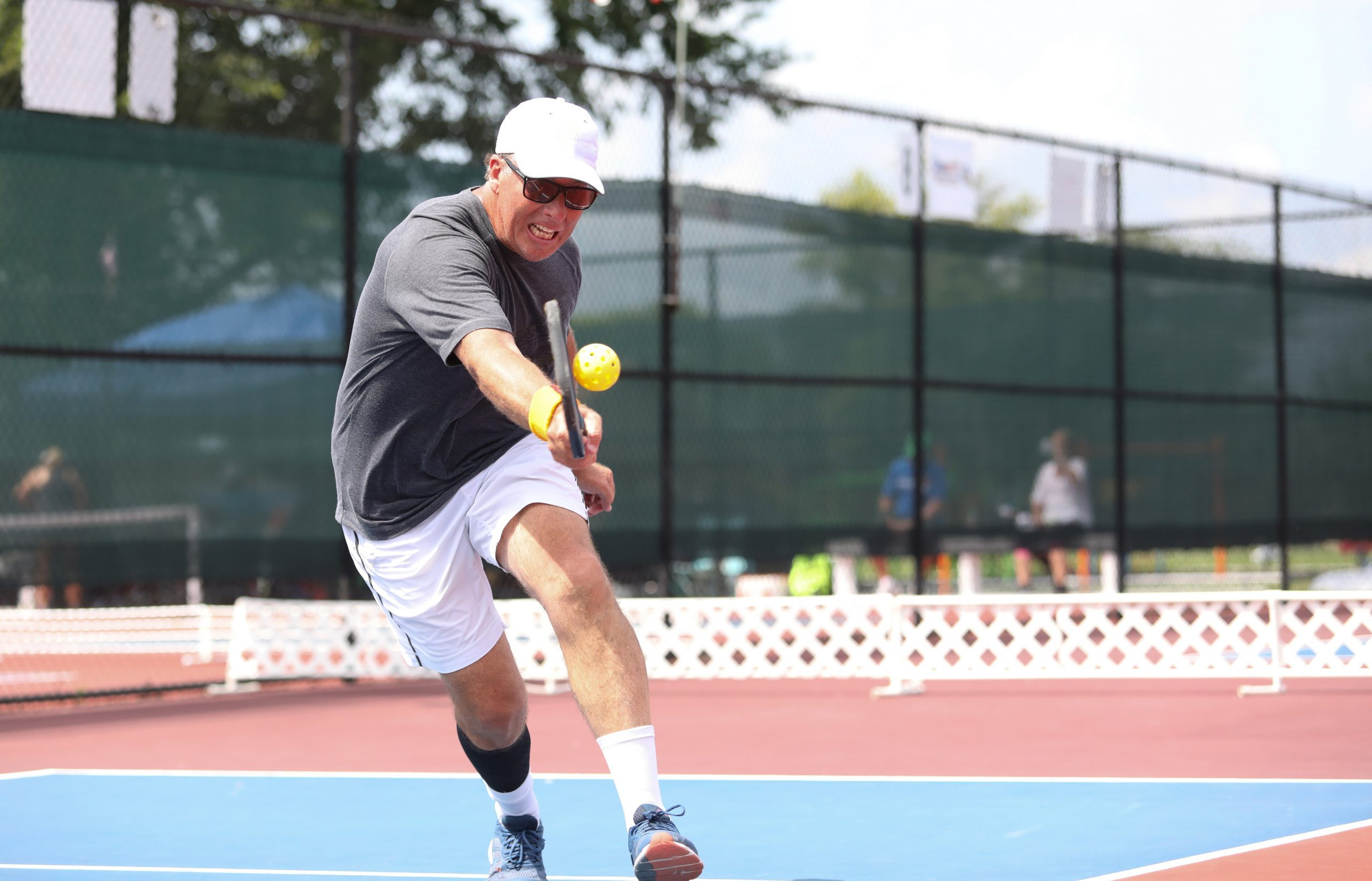 A gentleman competes in a pickleball tournament